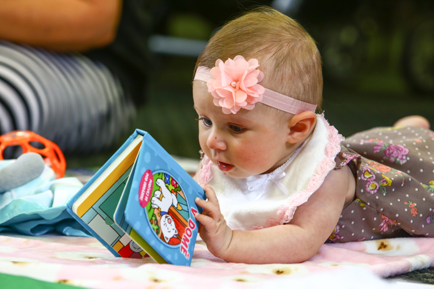 Baby playing with book