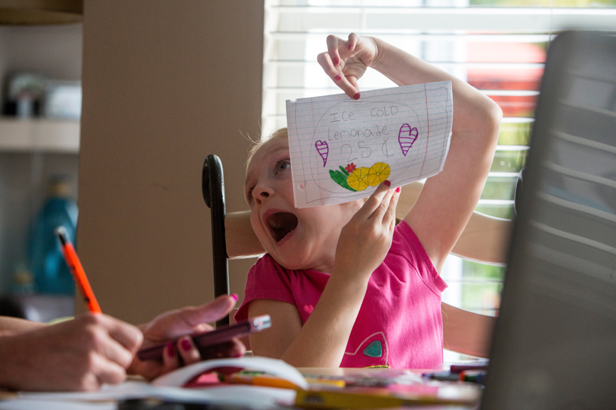 Young girl acting silly showing drawing