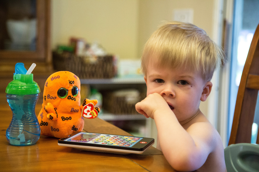 Young child playing on tablet