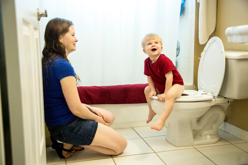 Mother and young son potty training