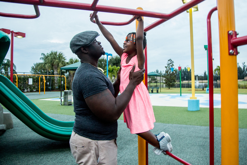 Father and daughter playing at park