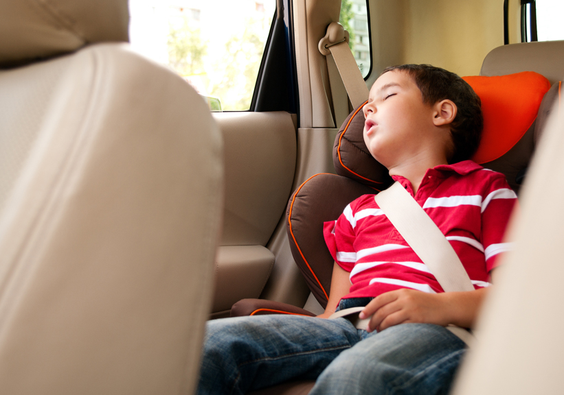 Young boy sleeping in carseat