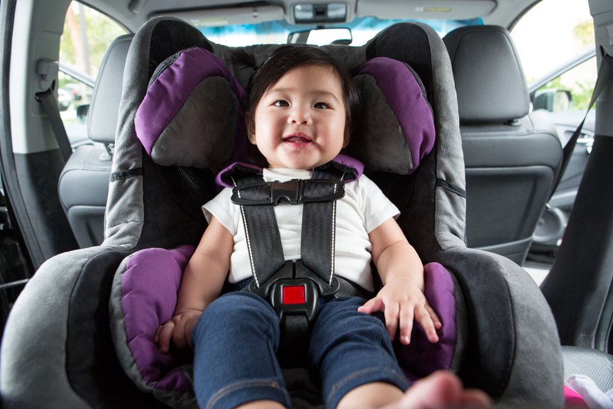 Young girl in carseat
