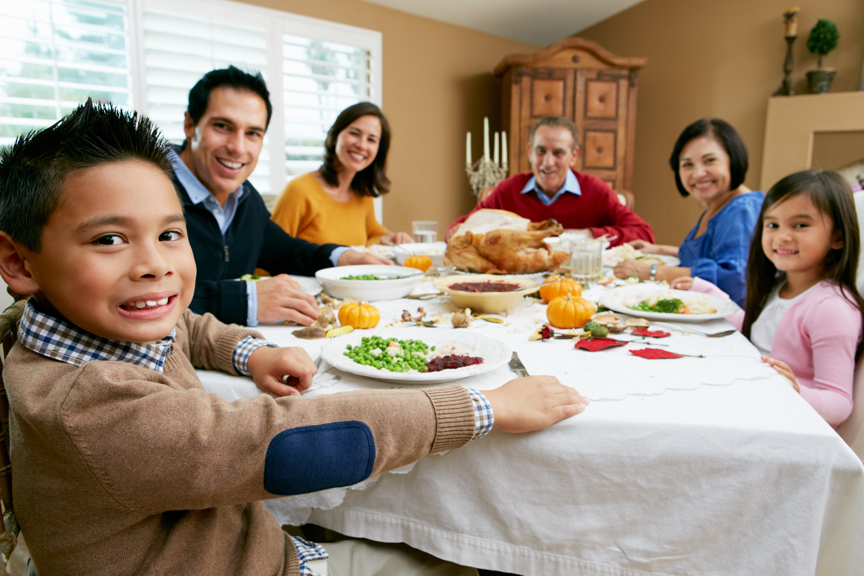 Family sharing Thanksgiving meal