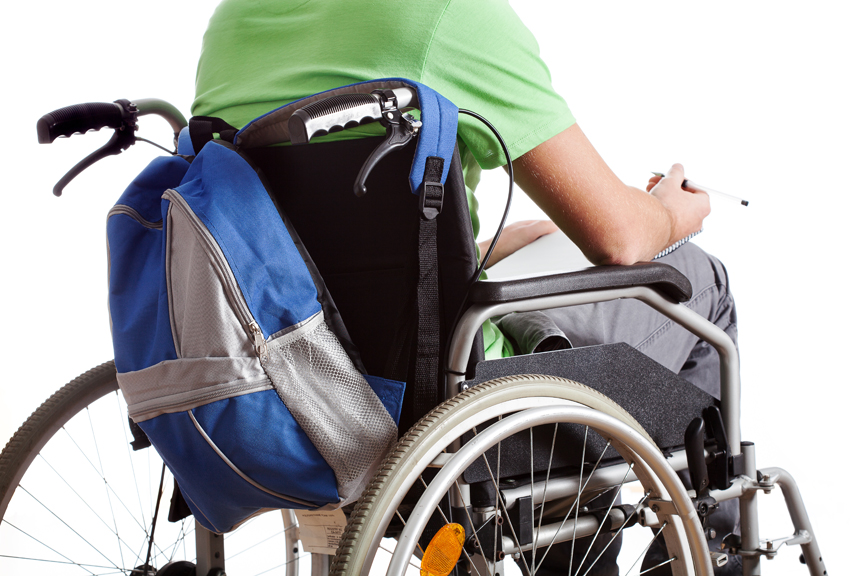 Person in a wheelchair with a backpack attached to it