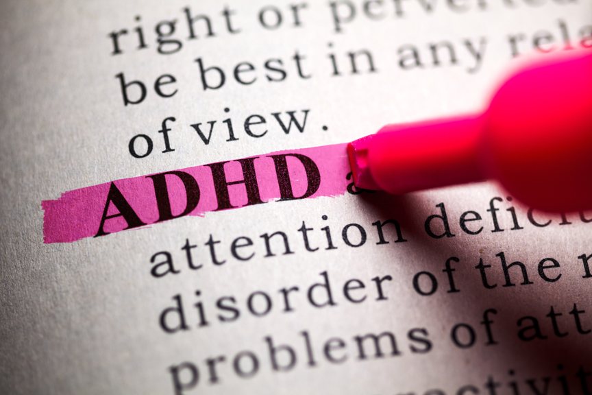 ADHD definition highlighted in dictionary in pink