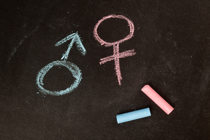 Male and female symbols in chalk