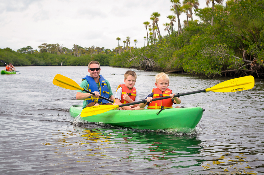 Man and two young boys in kayak