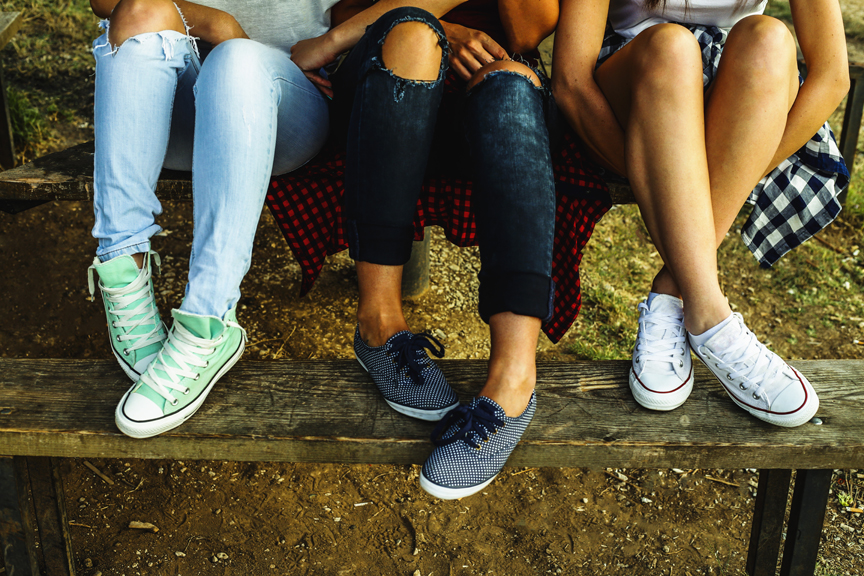 Teenagers sitting on picnic table