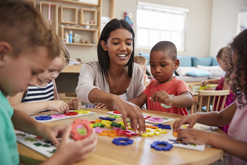 Child care teacher working with young children
