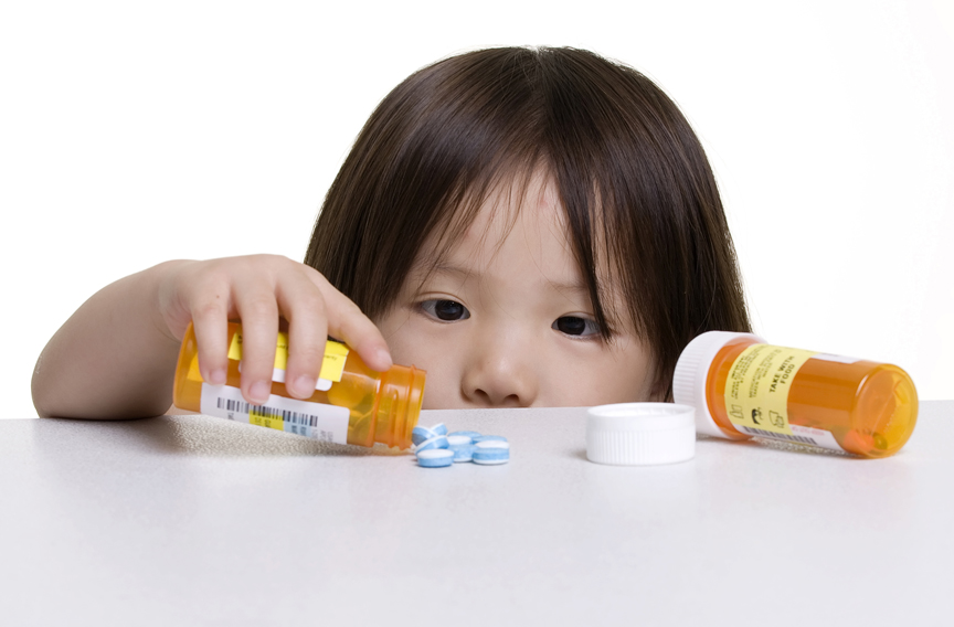Young girl spilling medicine