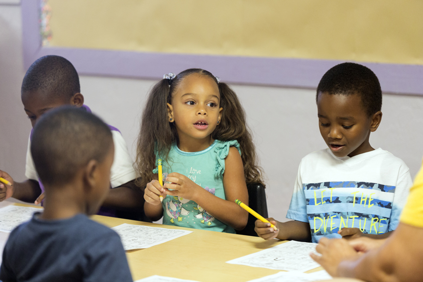 Children at child care center writing