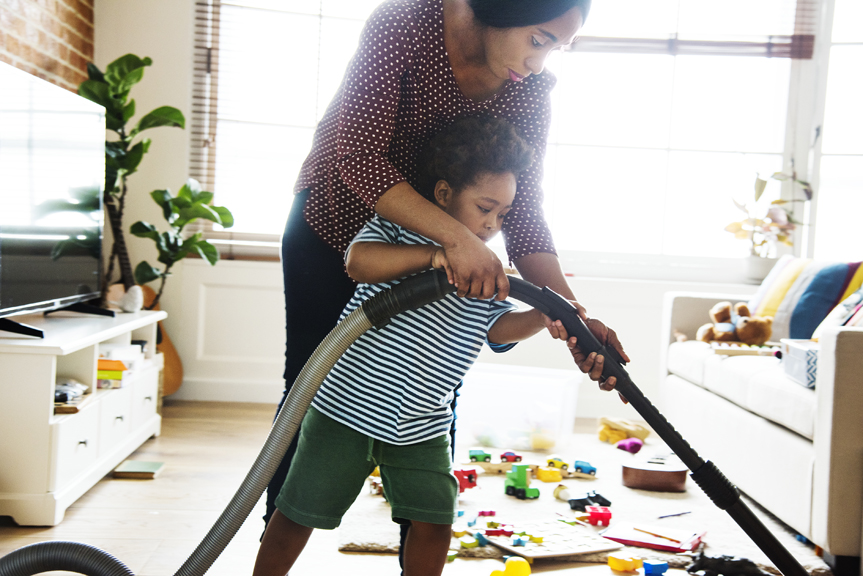 Woman and child vacuuming