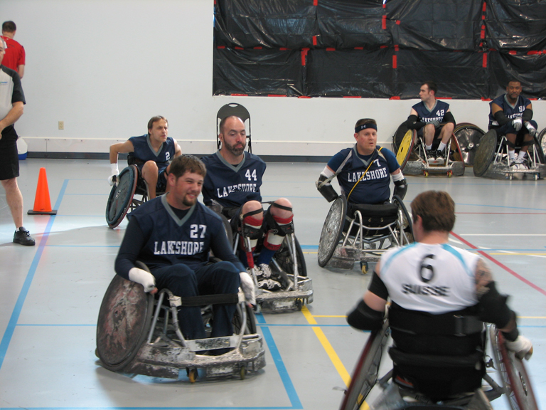 Knock and Roll event. Men playing basketball in wheelchairs.
